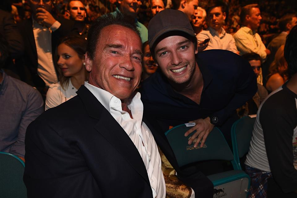 LAS VEGAS, NV - MAY 23:  (L-R) Arnold and Patrick Schwarzenegger in attendance during the UFC 187 event at the MGM Grand Garden Arena on May 23, 2015 in Las Vegas, Nevada.  (Photo by Jeff Bottari/Zuffa LLC/Zuffa LLC via Getty Images)