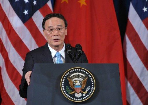Vice Premier Wang Qishan speaks during the opening session of the 2011 US-China Strategic and Economic Dialogue in Washington, DC. US Treasury Secretary Timothy Geithner urged China to allow its currency to strengthen further and push forward economic reforms, which he said were crucial to the global recovery
