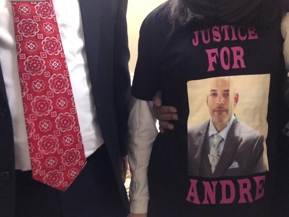"Andre Hill, fatally shot by Columbus police on Dec. 22, is memorialized on a shirt worn by his daughter, Karissa Hill, on Thursday, Dec. 31, 2020, in Columbus, Ohio. Karissa Hill said she considered her father an ""everything man"" because he did so many things. (AP Photo/Andrew Welsh-Huggins)"