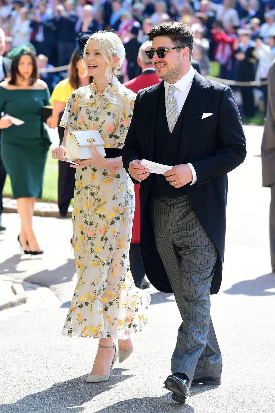 <p>Carey Mulligan looked ethereal in her suitably British floaty floral tea dress by designer Erdem for Harry and Meghan's special day. </p>
