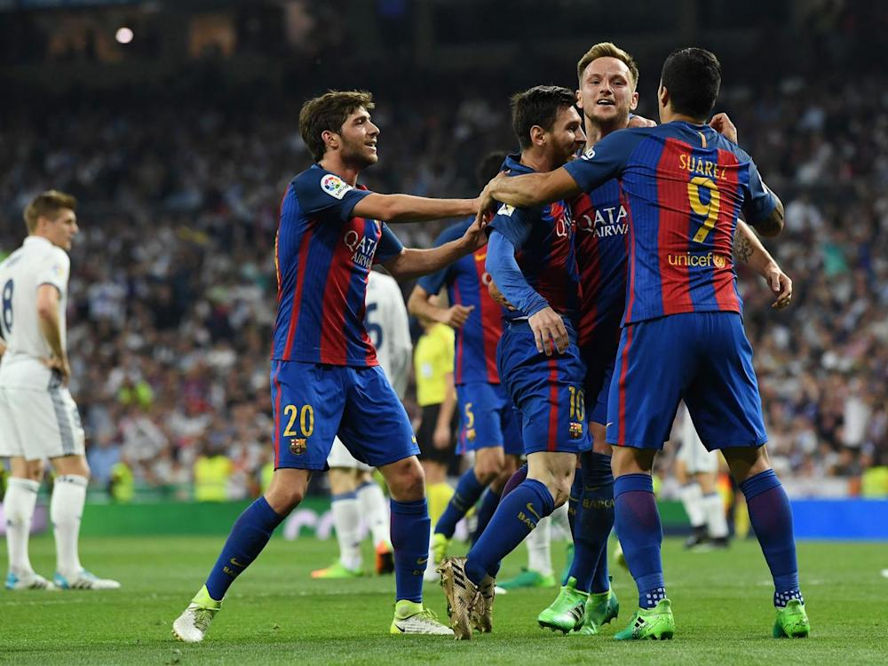 Barcelona celebrate after Messi's first goal levels the scores (Getty)