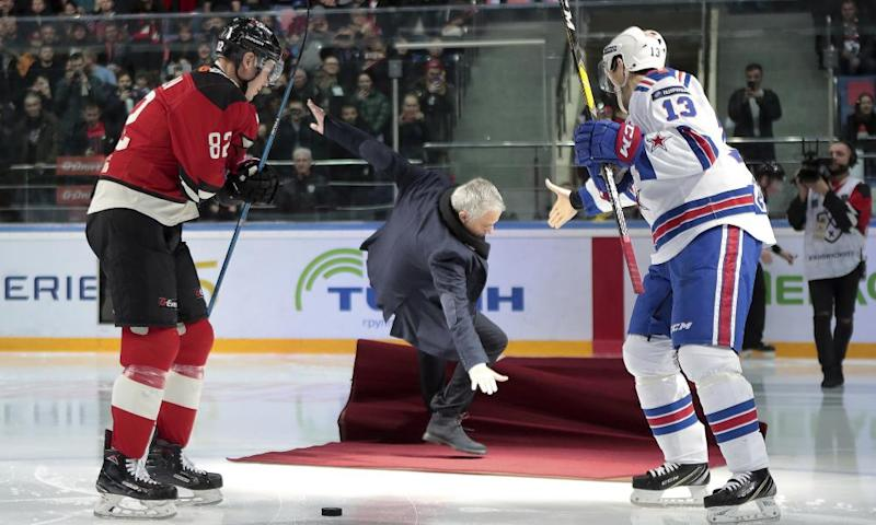 Former Manchester United coach Jose Mourinho falls after making the first puck drop at a Russian hockey game