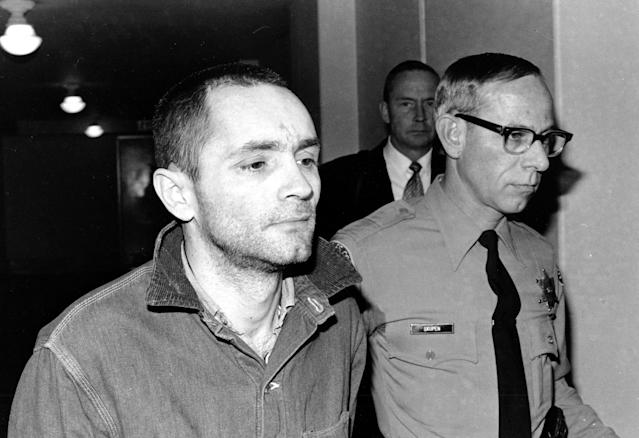 <p>Charles Manson is escorted to court for formal sentencing in Los Angeles, on April 19, 1971. He is convicted with three women followers of murder-conspiracy in the slayings of actress Sharon Tate and six others. (Photo: AP) </p>