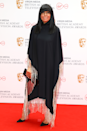 <p>Claudia Winkleman loves a fringe, and this glittery trim dress is a case in point.</p>