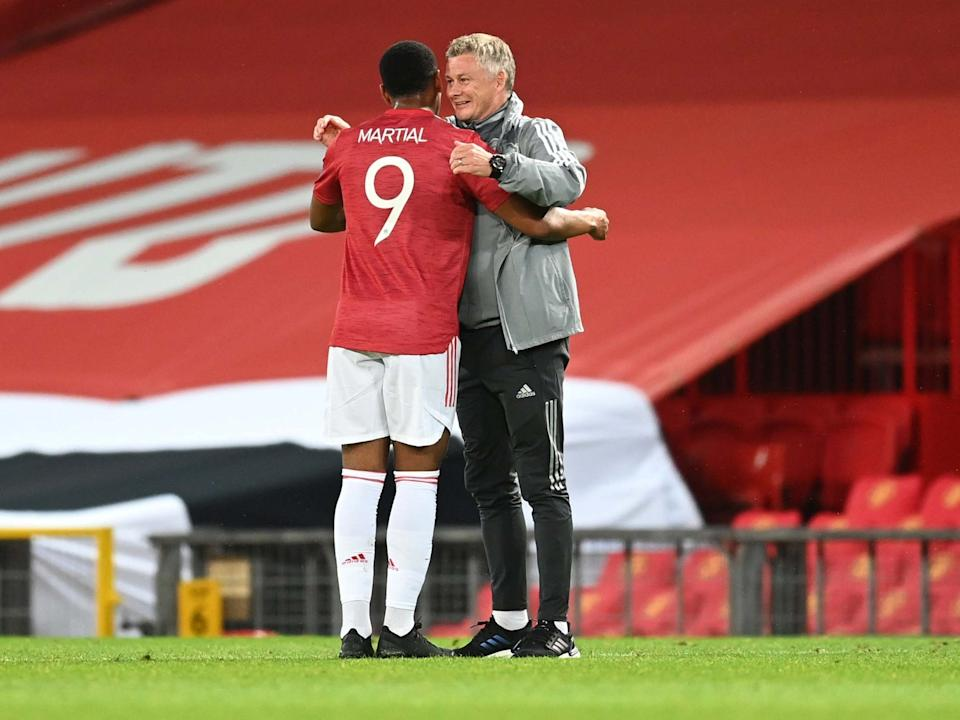 Anthony Martial and Ole Gunnar Solskjaer embrace at full-time: Getty Images