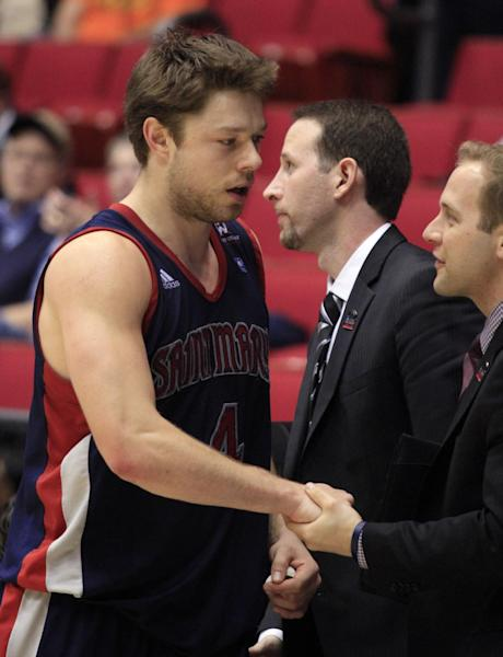 St. Mary's guard Matthew Dellavedova (4) is congratulated as he leaves the game against Middle Tennessee in a first-round match-up of the NCAA men's college basketball tournament, Tuesday, March 19, 2013, in Dayton, Ohio. Dellavedova led St. Mary's to a 67-54 win with 22 points. (AP Photo/Skip Peterson)