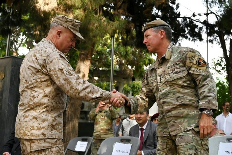"""General Austin """"Scott"""" Miller (R) -- the highest-ranked officer on the ground in Afghanistan -- handed command to General Kenneth McKenzie (L)"""