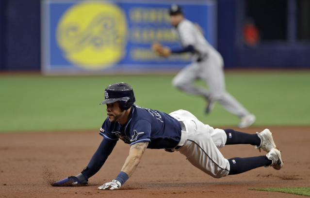 Tampa Bay Rays' Tommy Pham steals third base against the Seattle Mariners during the first inning of a baseball game Wednesday, Aug. 21, 2019, in St. Petersburg, Fla. (AP Photo/Chris O'Meara)