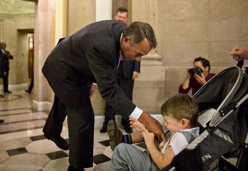 House Speaker John Boehner of Ohio tickles John Griffin III, son of Rep. Tim Griffin, R-Ark., outside his office, after a House vote, Thursday, Oct. 10, 2013, on Capitol Hill in Washington. Boehner said Thursday he will give President Barack Obama a proposal temporarily extending the government's ability to borrow money and averting a potential default _ but only if he agrees to negotiate over ending a partial government shutdown and a longer-term increase in the debt ceiling. (AP Photo/ Evan Vucci)