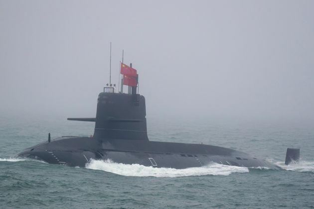 A Great Wall 236 submarine of the Chinese People's Liberation Army (PLA) Navy, billed by Chinese state media as a new type of conventional submarine, participates in a naval parade to commemorate the 70th anniversary of the founding of China's PLA Navy in the sea near Qingdao, in eastern China's Shandong province on April 23, 2019. - China celebrated the 70th anniversary of its navy by showing off its growing fleet in a sea parade featuring a brand new guided-missile destroyer. (Photo by Mark Schiefelbein / POOL / AFP)        (Photo credit should read MARK SCHIEFELBEIN/AFP via Getty Images) (Photo: MARK SCHIEFELBEIN via Getty Images)
