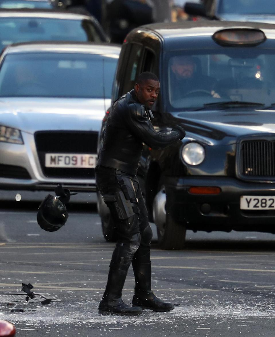 Actor Idris Elba throws his helmet during filming in Glasgow city centre (Andrew Milligan/PA)