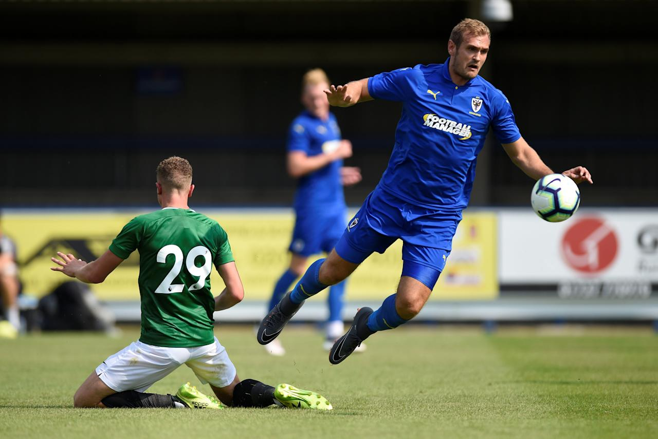 Soccer Football - Pre Season Friendly - AFC Wimbledon v Brighton & Hove Albion - The Cherry Red Records Stadium, London, Britain - July 21, 2018   Brighton's Ben Barclay in action with AFC Wimbledon's James Hanson   Action Images via Reuters/Adam Holt