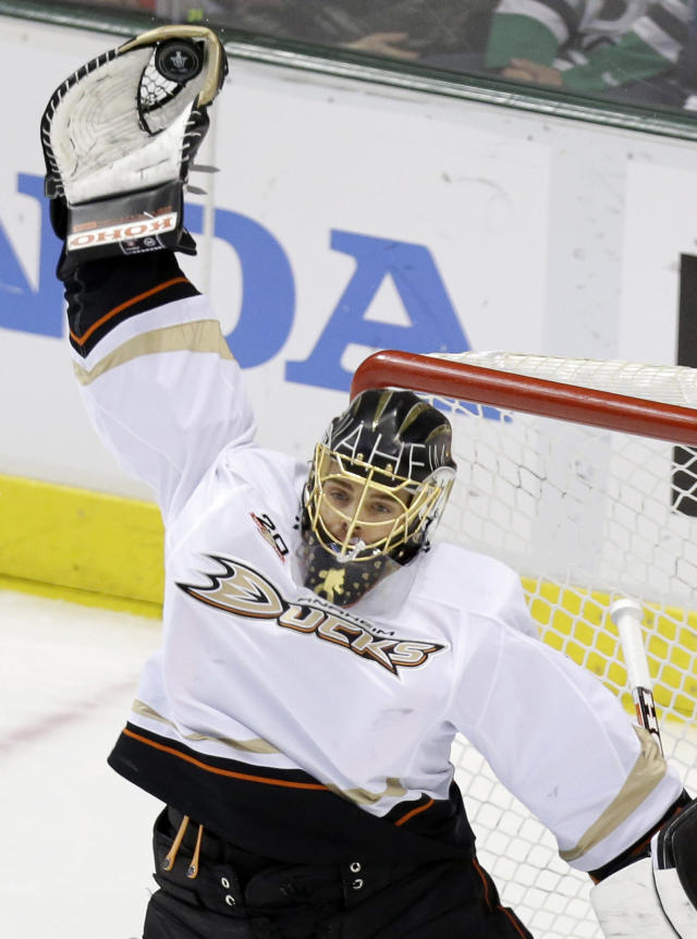 Anaheim Ducks goalie Jonas Hiller catches the puck during the second period of Game 6 of a first-round NHL hockey playoff series against the Dallas Stars in Dallas, Sunday, April 27, 2014. (AP Photo/LM Otero)