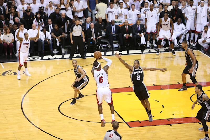 MIAMI, FL - JUNE 20: LeBron James #6 of the Miami Heat shoots against Kawhi Leonard #2 of the San Antonio Spurs during Game Seven of the 2013 NBA Finals on June 20, 2013 at American Airlines Arena in Miami, Florida. NOTE TO USER: User expressly acknowledges and agrees that, by downloading and or using this photograph, User is consenting to the terms and conditions of the Getty Images License Agreement. Mandatory Copyright Notice: Copyright 2013 NBAE (Photo by Joe Murphy/NBAE via Getty Images)
