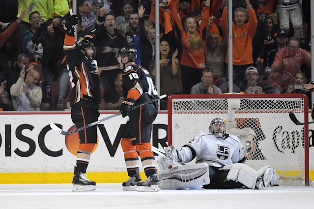 Anaheim Ducks left wing Patrick Maroon, left, celebrates his goal with teammate Corey Perry, center, as Los Angeles Kings goalie Jonathan Quick, right, looks on during the first period in Game 2 of an NHL hockey second-round Stanley Cup playoff series, Monday, May 5, 2014, in Anaheim, Calif. (AP Photo/Mark J. Terrill)