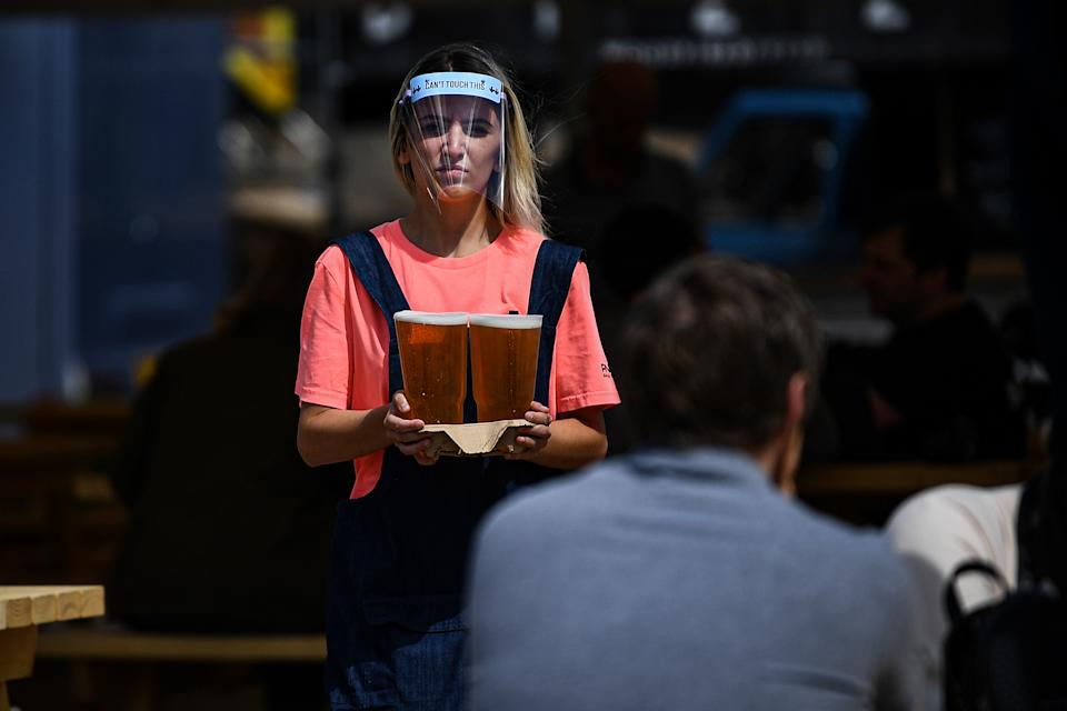 Pubs are now open in England but staff must wear protective equipment. (Getty)