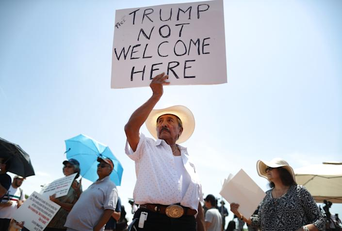 Miguel de Anda, born and raised in El Paso, holds a sign reading 'Trump Not Welcome Here' at a protest against President Trump's visit following a mass shooting, which left at least 22 people dead, on Aug. 7, 2019 in El Paso, Texas. (Photo: Mario Tama/Getty Images)