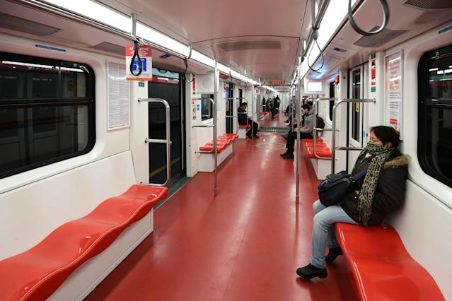A few commuters travel in the underground metro in Milan on March 10, 2020 after Italy imposed unprecedented national restrictions on its 60 million people. (Credit: Miguel Medina/AFP)