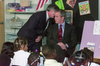 FILE - In this Tuesday, Sept. 11, 2001 file photo, White House chief of staff Andrew Card whispers into the ear of President George W. Bush to give him word of the plane crashes into the World Trade Center, during a visit to the Emma E. Booker Elementary School in Sarasota, Fla. (AP Photo/Doug Mills, File)