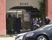 Los Angeles Police Chief Michel Moore exits an apartment complex as police investigate in Reseda, Calif., Saturday, April 10, 2021. The mother of three children — all under the age of 5 — found slain inside a Los Angeles apartment Saturday morning has been arrested, police said. (AP Photo/Damian Dovarganes)