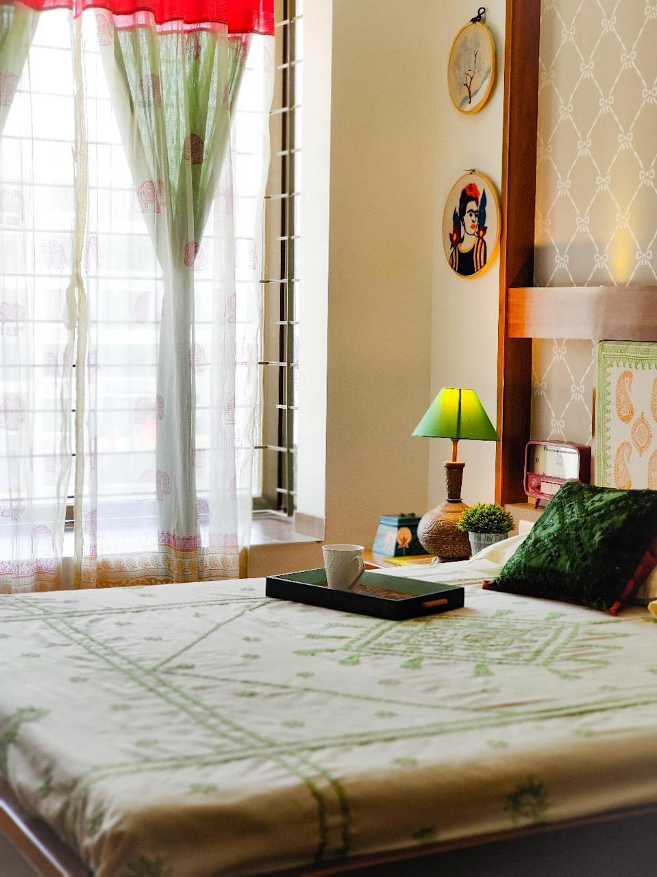 """""""I love block prints. I have incorporated them on [the upholstered] headboard and curtains [in the bedroom],"""" says Bhakti."""