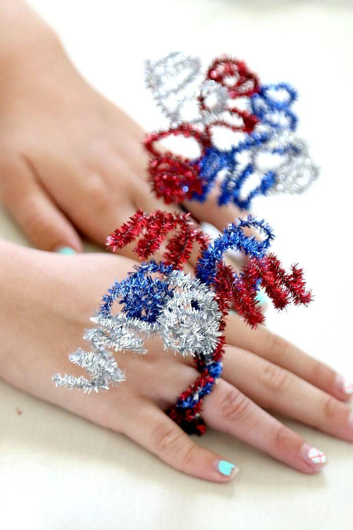 """<p>These bursting bands are made with sparkly red, white, and blue pipe cleaners. </p><p><em>Get the tutorial from <a href=""""http://www.momdot.com/exploding-pipe-cleaner-firework-ring/"""" rel=""""nofollow noopener"""" target=""""_blank"""" data-ylk=""""slk:MomDot"""" class=""""link rapid-noclick-resp"""">MomDot</a>.</em></p><p><strong><strong>What You'll Need:</strong> </strong><a href=""""https://www.amazon.com/Rimobul-Glitter-Creative-Chenille-Class/dp/B00NIG06HA/?tag=syn-yahoo-20&ascsubtag=%5Bartid%7C10070.g.2446%5Bsrc%7Cyahoo-us"""" rel=""""nofollow noopener"""" target=""""_blank"""" data-ylk=""""slk:Sparkly pipe cleaners"""" class=""""link rapid-noclick-resp"""">Sparkly pipe cleaners</a> ($7, Amazon)<br></p>"""