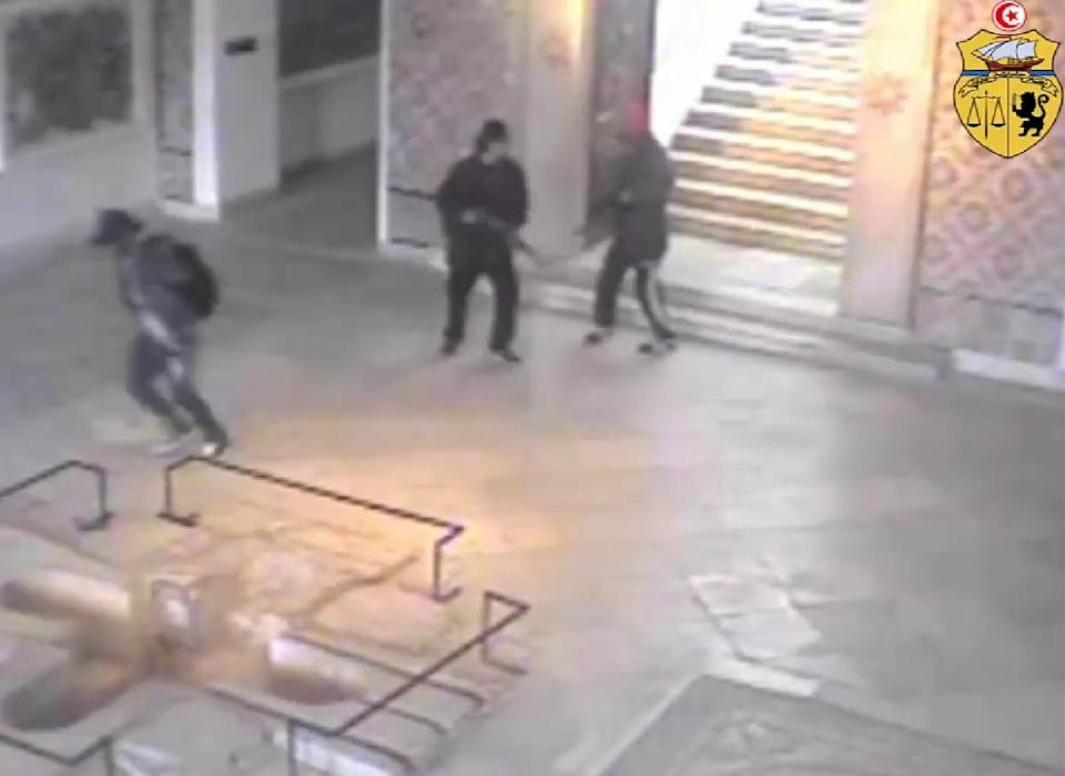 The two gunmen (R) who attacked Tunisia's National Bardo Museum are reportedly shown near a man (L) trying to escape in this image grab taken from CCTV footage released by the Tunisian interior ministry on its Facebook page on March 21, 2015 (AFP Photo/)