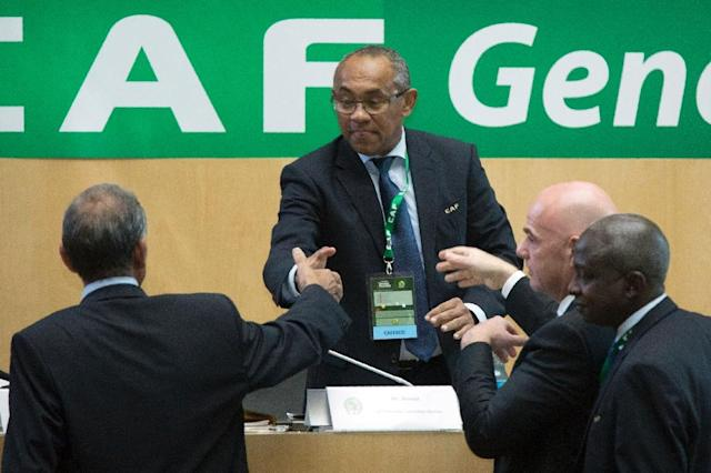 Ahmad Ahmad (C) of Madagascar is congratulated by FIFA president Gianni Infantino (2ndR) after being elected the new president of the Confederation of African Football (CAF) in Addis Ababa on 16 March 2017 (AFP Photo/Zacharias ABUBEKER)