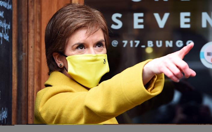 Nicola Sturgeon campaigning in her Glasgow Southside constituency - AFP