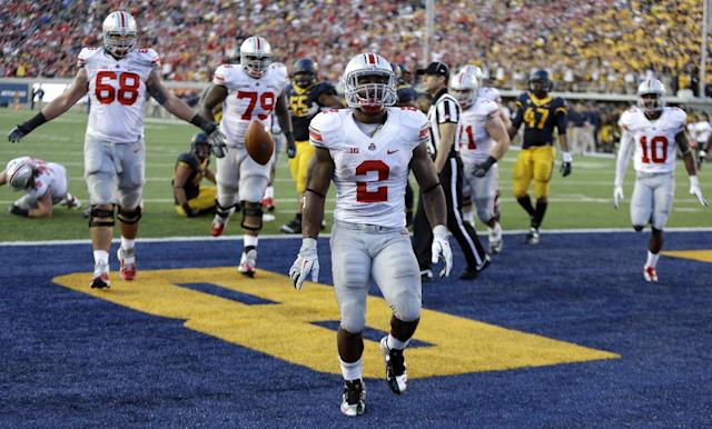 FILE - In this Saturday, Sept. 14, 2013 file photo, Ohio State's Jordan Hall (2) celebrates after scoring a touchdown against California during an NCAA college football game in Berkeley, Calif. Carlos Hyde was the unbeaten Buckeyes' leading scorer and second-leading rusher a year ago. Now he'll be battling Hall and others for carries as head coach Urban Meyer tries to sort out an abundance of riches. (AP Photo/Ben Margot, File)