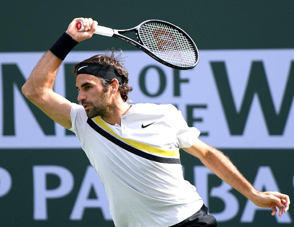 Roger Federer blasted 10 aces but had five double faults and his serve was broken twice as he lost 6-4, 6-7 (8/10), 7-6 (7/2) to Juan Martin Del Potro in the final at Indian Wells (AFP Photo/Harry How)