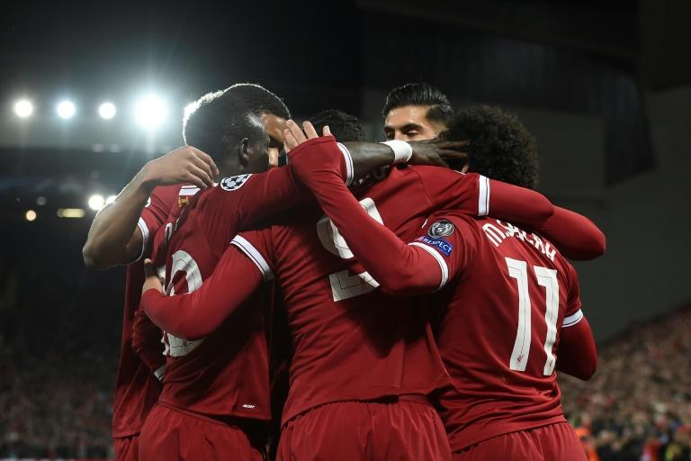 Liverpool players surround Philippe Coutinho after he scored their second goal during their match against Spartak Moscow in Liverpool, north-west England on December 6, 2017