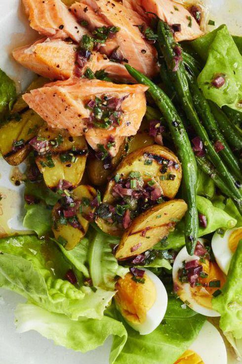 """<p>Perfectly flaky salmon, potatoes, and hard-boiled eggs make an elegant summer salad that's perfect for any picnic. </p><p><a href=""""https://www.womansday.com/food-recipes/food-drinks/recipes/a59397/salmon-nicoise-salad-recipe/"""" rel=""""nofollow noopener"""" target=""""_blank"""" data-ylk=""""slk:Get the recipe for Salmon Nicoise Salad."""" class=""""link rapid-noclick-resp""""><u><em>Get the recipe for Salmon Nicoise Salad.</em></u></a> </p>"""
