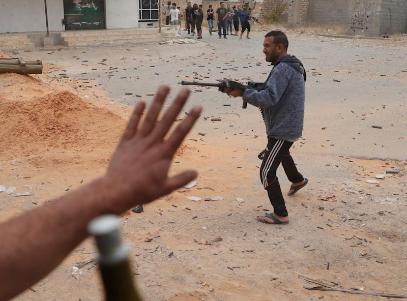 A fighter loyal to Libya's U.N.-backed government (GNA) fires a weapon during a clash with forces loyal to Khalifa Haftar at the outskirts of Tripoli, Libya May 21, 2019. (Photo: Goran Tomasevic/Reuters)