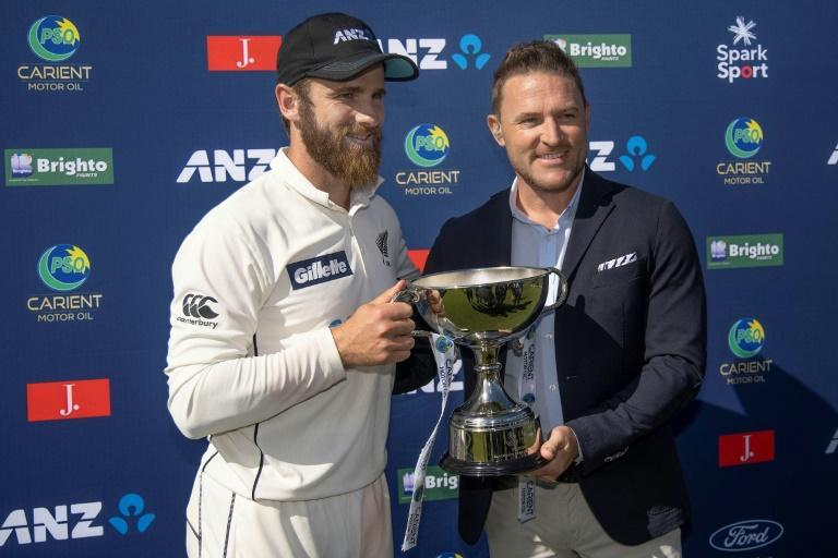 New Zealand captain Kane Williamson (left) is presented with the trophy for beating Pakistan by former captain Brendon McCullum, who Williamson credited for introducing the changes that led to the Black Caps becoming the world's top-ranked team