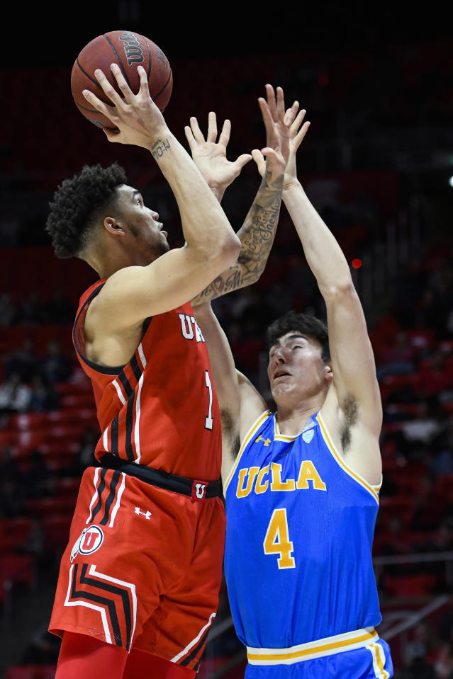 Utah forward Timmy Allen (1) shoots over UCLA guard Jaime Jaquez Jr. during the second half of an NCAA college basketball game Thursday, Feb. 20, 2020, in Salt Lake City. (AP Photo/Alex Goodlett)