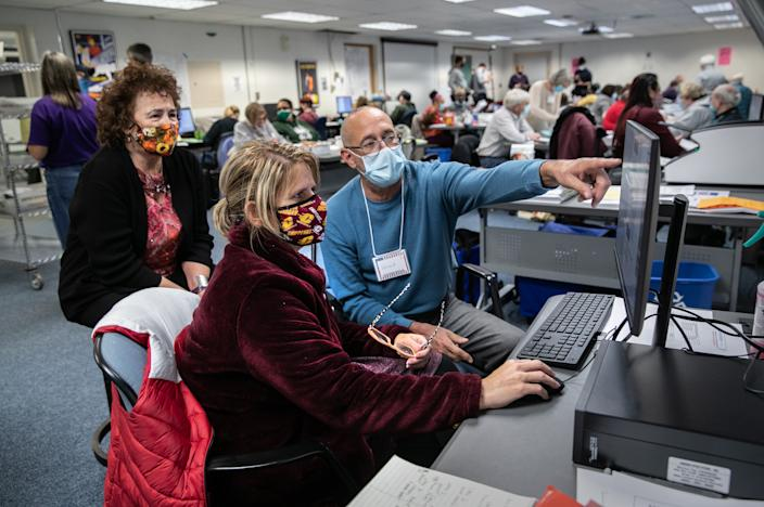 Election workers adjudicate scans of challenged ballots at the Lansing city clerk's office on election night on November 03, 2020 in Lansing, Michigan. (John Moore/Getty Images)