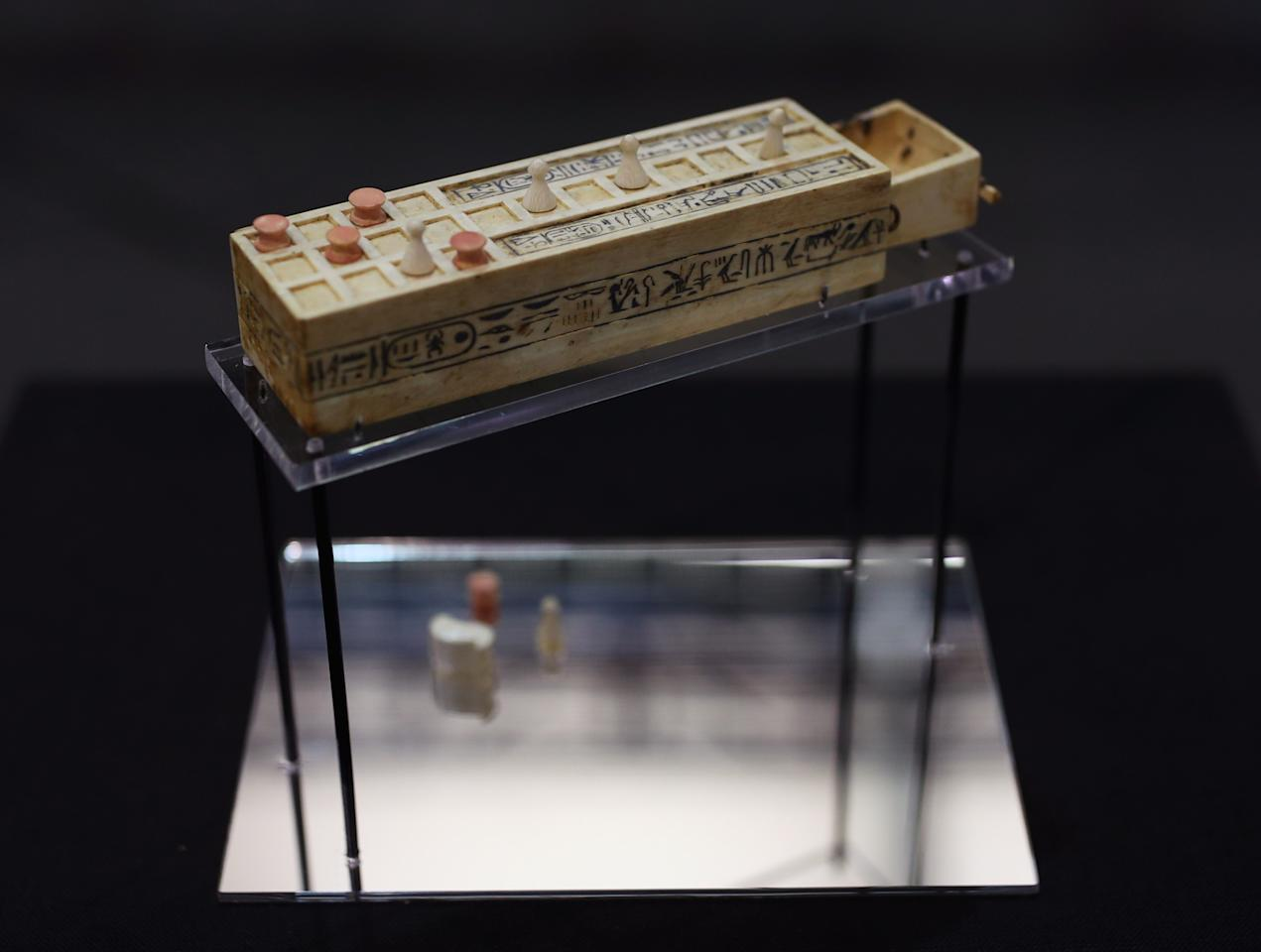 A miniature senet game board - where players moved five discs and five cone pieces across the board and threw knuckle bones to determine their moves (Picture: Getty)