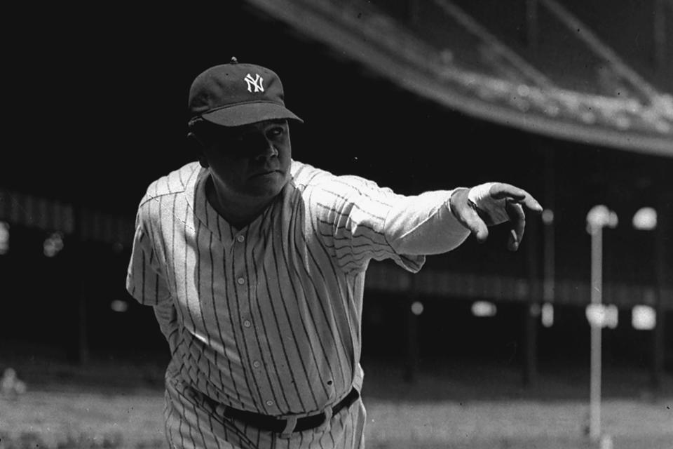 FILE - New York Yankee outfielder Babe Ruth is shown in a posed pitching stance at Yankee Stadium in New York, in this 1933 file photo. Two-way phenom Shohei Ohtani (3-1, 2.58 ERA), who leads the majors with 28 home runs, makes his first pitching appearance at Yankee Stadium when he starts for the Los Angeles Angels against New York. Ohtani is set to become the first pitcher to start one game after hitting two home runs for his team since Yankees great Babe Ruth on Sept. 28, 1930. (AP Photo/File)