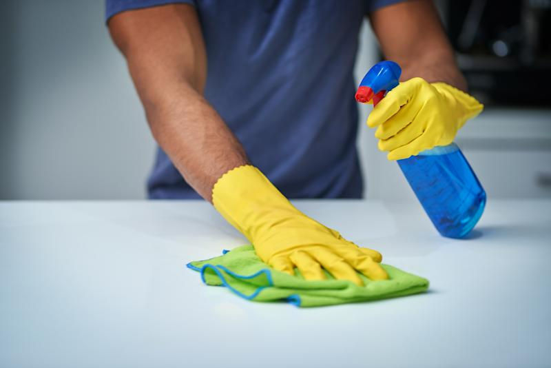 Shot of an unrecognizable man doing household chores