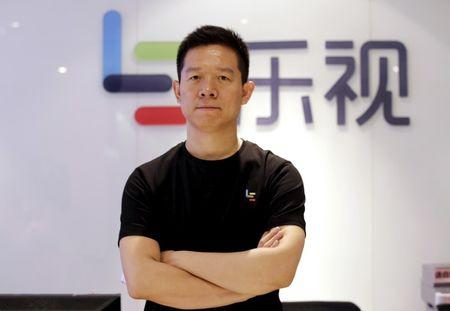 FILE PHOTO: Jia Yueting, co-founder and head of Le Holdings Co Ltd, also known as LeEco and formerly as LeTV, poses for a photo in front of a logo of his company after a Reuters interview at LeEco headquarters in Beijing, China, picture taken April 22, 2016. REUTERS/Jason Lee/File Photo - RTX2WSUP