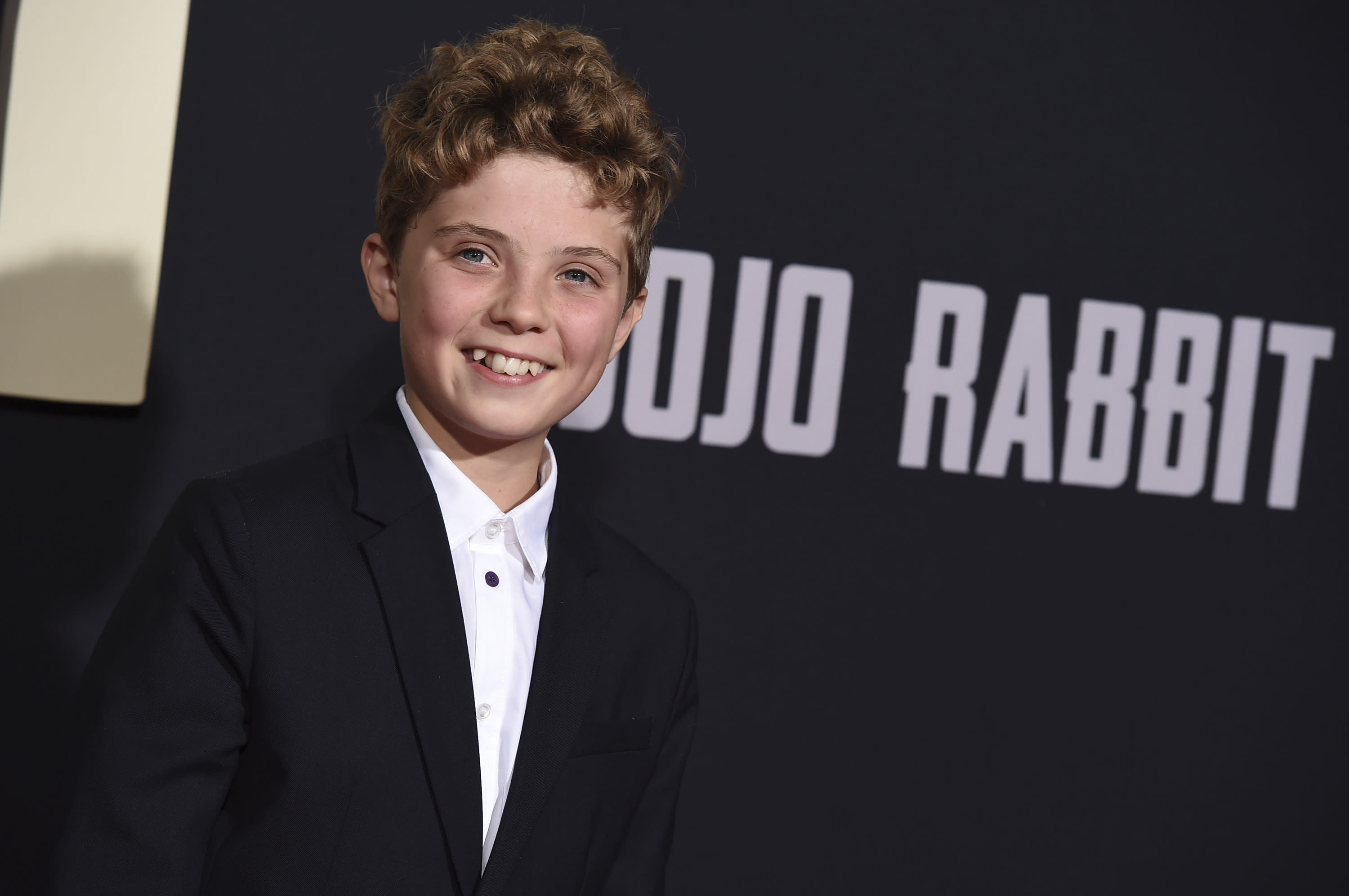"Roman Griffin Davis arrives at the Los Angeles premiere of ""Jojo Rabbit"" at the Hollywood American Legion Post 43 on Tuesday, Oct. 15, 2019. (Photo by Jordan Strauss/Invision/AP)"