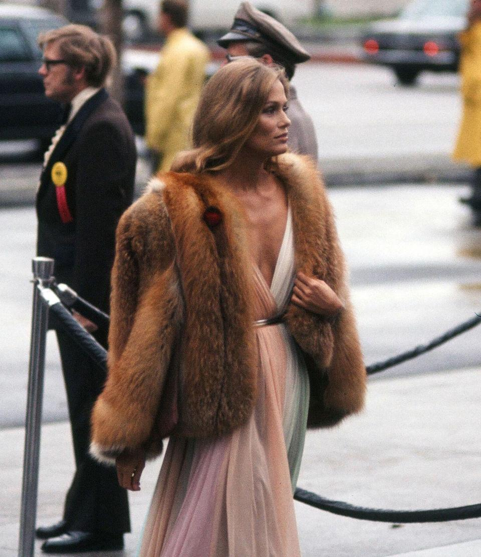 <p>Halston dresses epitomized the decade's disco glam look—which Lauren Hutton took even further by adding a plush fur coat. </p>