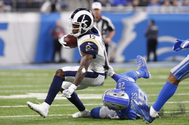 Los Angeles Rams wide receiver Brandin Cooks (12) is stopped by Detroit Lions strong safety Quandre Diggs (28) during the first half of an NFL football game, Sunday, Dec. 2, 2018, in Detroit. (AP Photo/Paul Sancya)