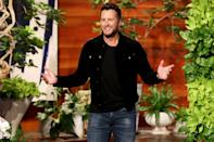 <p>Country star Luke Bryan plays to the crowd during his appearance on <em>The Ellen DeGeneres Show</em> on Monday in Burbank, California.</p>