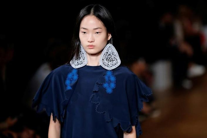 Lace dresses and earrings were everywhere in the Stella McCartney Paris fashion week show (AFP Photo/Thomas SAMSON)