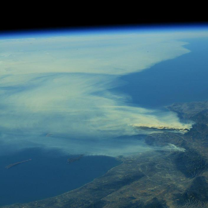 <p>A photo taken from the International Space Station and moved on social media by astronaut Randy Bresnik shows smoke rising from wildfire burning in Southern California, Dec. 6, 2017. (Photo: @AstroKomrade via Twitter) </p>