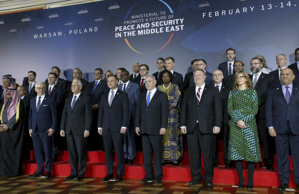 Front row third from left, United States Vice President Mike Pence, fourth from left, Poland's President Andrzej Duda, fifth from left, Israeli Prime Minister Benjamin Netanyahu and sixth from left, United States Secretary of State, Mike Pompeo, pose for a group photo at the Royal Castle in Warsaw, Poland, Wednesday, Feb. 13, 2019. The Polish capital is host for a two-day international conference on the Middle East, co-organized by Poland and the United States. (AP Photo/Michael Sohn)