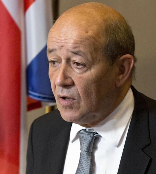 French Defense Minister Jean-Yves Le Drian arrives for a meeting of EU foreign and defense ministers at the EU Council building in Brussels on Tuesday, Nov. 19, 2013. EU foreign and defense ministers meet in Brussels Tuesday to discuss, among other issues, the situation in Libya. (AP Photo/Virginia Mayo)