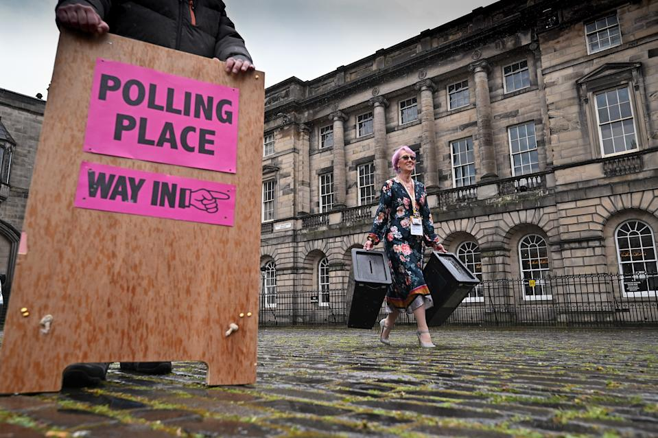 EDINBURGH, SCOTLAND - MAY 04: Staff at Edinburgh City Council move ballot boxes as they're taken for distribution to polling stations on May 4, 2021 in Edinburgh, Scotland. Political party leaders have been out campaigning in the final two day before voters go to the polls open on Thursday in the Scottish Parliamentary election. (Photo by Jeff J Mitchell/Getty Images)